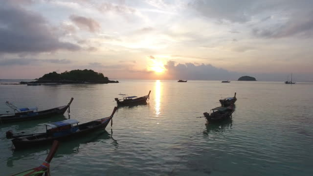 Flying over sea and harbor at sunrise or sunset. video