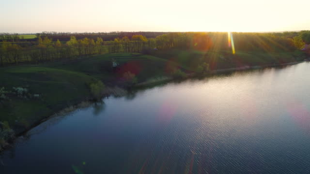 Flying over the beautiful spring river. Aerial camera shot. Ukraine video