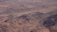 Flying over the desert mountains video