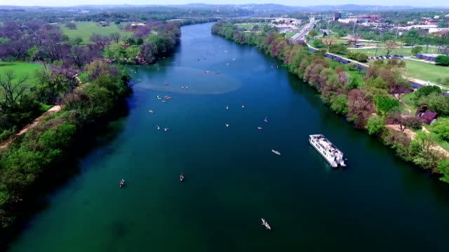 Flying over the Middle of Lake Aerial View Austin Texas Colorado River Fun Spring water activities with kayakers and Party Boat during SXSW Spring Break 2016 video