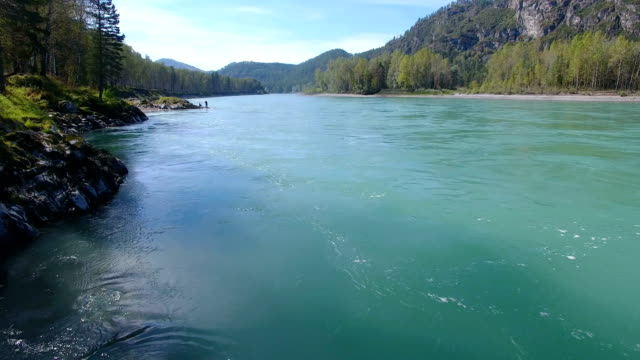 Flying over the mountain river. Sunny day. video