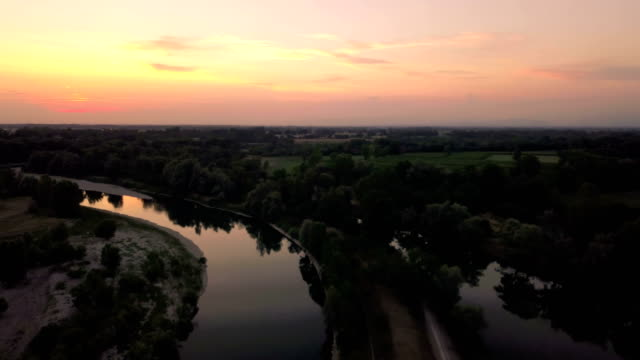 Flying over the river at sunset video