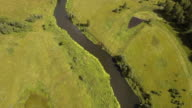 Flying over the river.Aerial video video