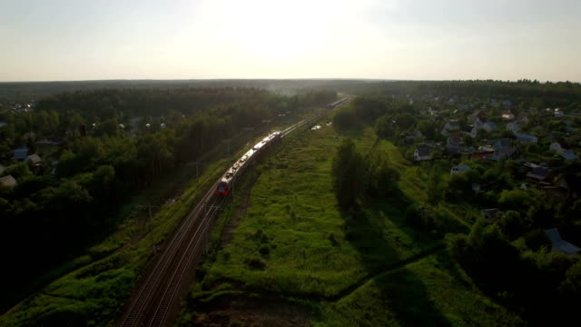 Flying over train in the countryside, Russia video