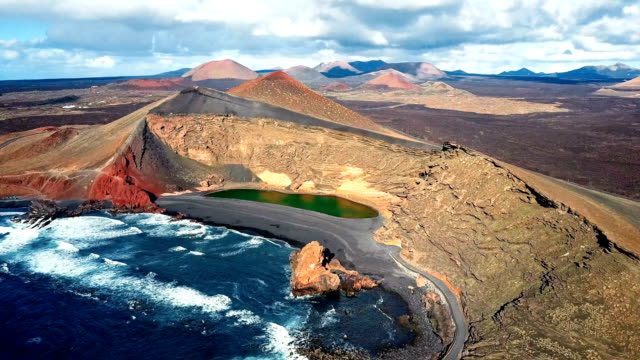 Flying over Volcanic Lake El Golfo, Lanzarote, Canary Islands, Spain video