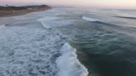 Flying Over Waves at Sunset video
