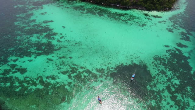 Flying over white beach and clean sea at Andaman. video