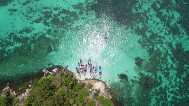 Flying over white beach, clean sea and island video