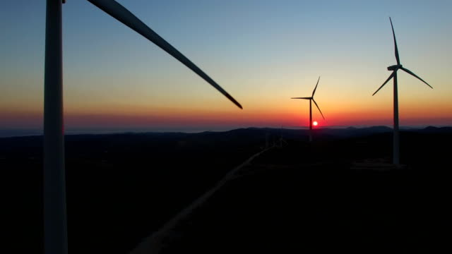 Flying over windmills at dusk video