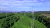 AERIAL: Flying pass transmission towers and high voltage power lines video