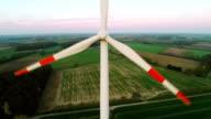 Flying past wind turbine in field video