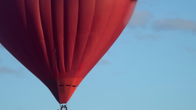 flying red hot air balloon in the shape of a heart flying video