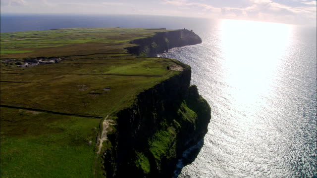 Flying Round Peninsular At Old Watch Tower  - Aerial View - Munster, Co Clare, Ireland video