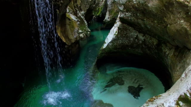 AERIAL: Flying through beautiful narrow gorge with river and waterfalls video