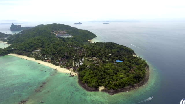Flying through Beautiful Tranquil White Beach with Crystal-clear Water with drone, Aerial view video