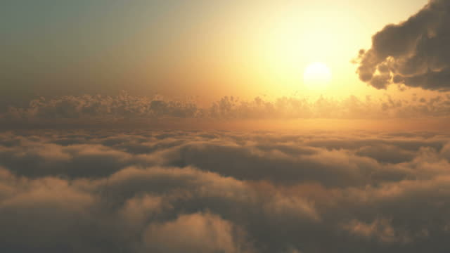 Flying through clouds at sunrise or sunset. video