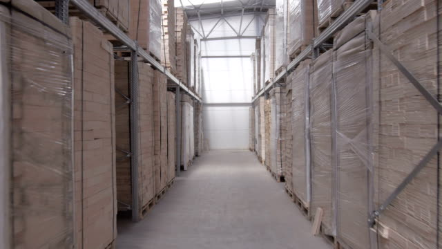 Flying through the big factory warehouse. video
