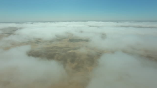 Flying through the clouds over the Namibian desert video