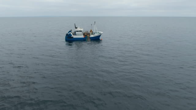 Flying Towards a Commercial Ship Fishing with Trawl Net at the Sea. video