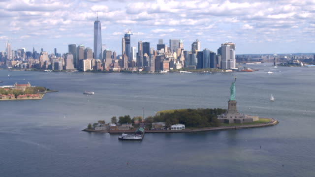 AERIAL: Flying towards Statue of Liberty in front of downtown New York city video