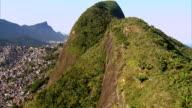 Flying up Dois Irmãos Hill overlooking Rio de Janeiro, Brazil video