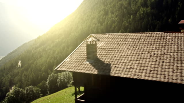 Flying view on alpine village and nature video