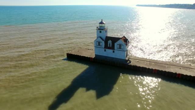 Flyover of Scenic Harbor, Pier, Lighthouse on Lake Michigan video