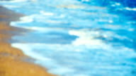 foaming waves on the beach, blurred image video