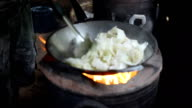 focus: cooking Brussels sprouts in a hot pan under low light video