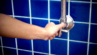 Focus of faucet, Shower opening valve by women in slow motion video