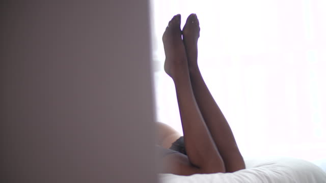 Focus on sexy womans butt in black lingerie video