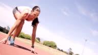 Focused sportswoman running video