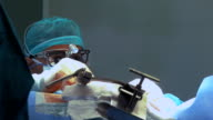Focused surgeon operates a patient video