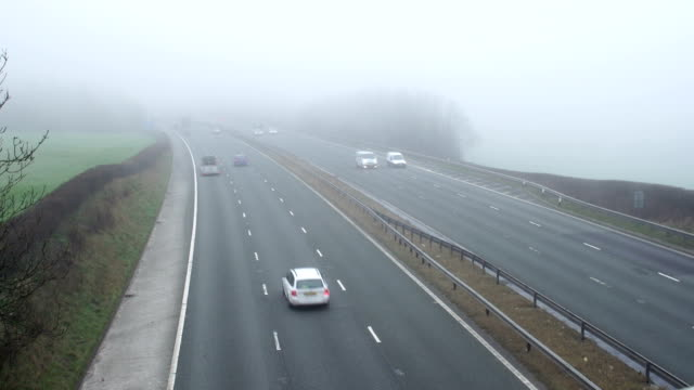 Fog / Mist on busy Motorway / Highway Road (Traffic) video
