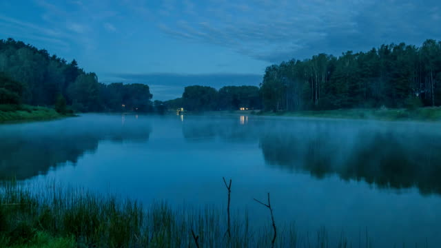Fog over the lake. Night time video