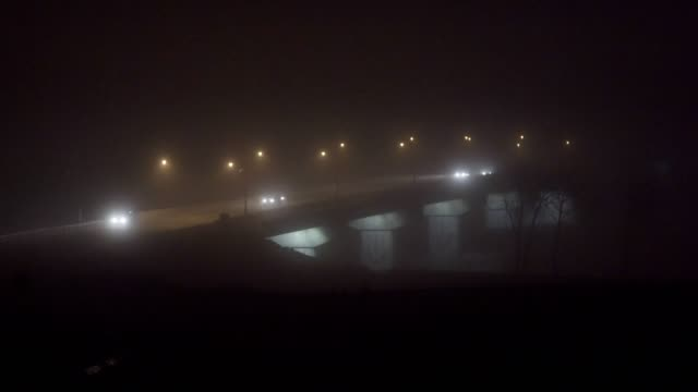 Foggy bridge at night video