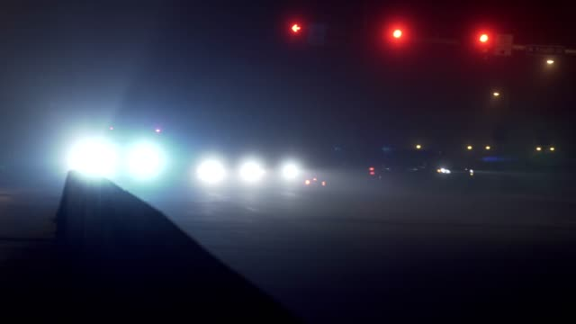 Foggy intersection with cars video