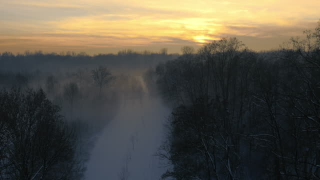 AERIAL Foggy wintry scene at sunset video