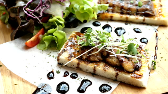 Foie gras on top of bread with sauce and vegetable video