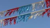 Foil flags flap in wind. video