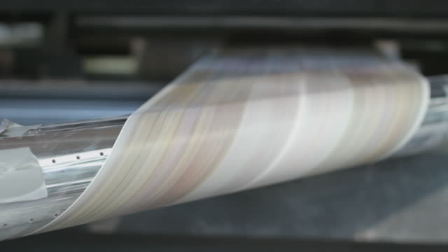 Folding paper at high speed on the production line of a printing factory video