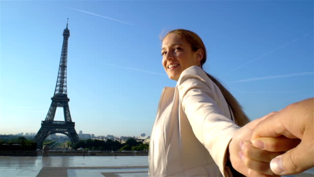 Follow Me Paris Happy Woman Leading her Boyfriend to Eiffel Tower video