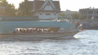 follow panning: transportation on river at Wat Arun, Bangkok, Thailand video