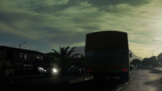 Following Cape Town bus down the main street in sunset video