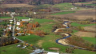 Following the Missisquoi River To Enosburg Falls  - Aerial View - Vermont,  Franklin County,  United States video