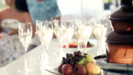 Fondue pot and wine glasses with fruit video
