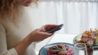 Food Blogger Taking Picture Of Meal In Restaurant On Mobile video