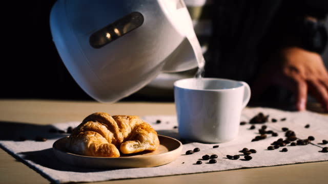 Food & Drink Cinemagraphs : Pouring hot water into cup of coffee. video