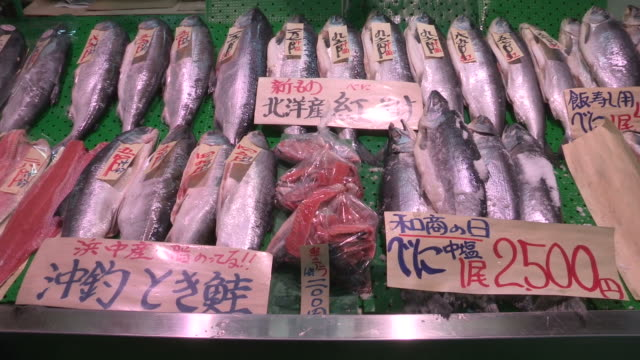 Food market. Produce and food on display at food market. Fishes on display at market store video