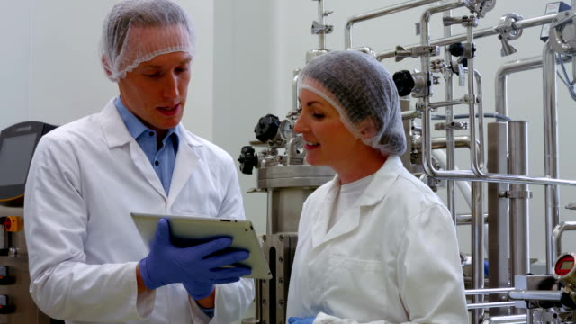 Food scientists working together in lab video